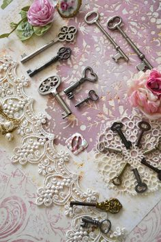keys... with lace and pearls... framed would make a beautiful display.