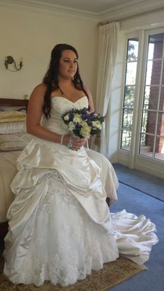 Blue and white bouquet. Wedding flowers. Maggie sottero wedding dress