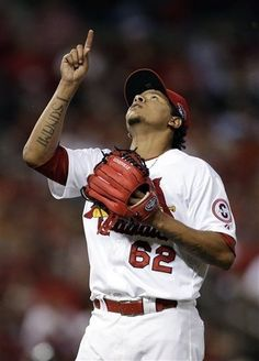 relief pitcher Carlos Martinez celebrates after striking out Pittsburgh Pirates' Jordy Mercer to end the top of the eighth inning in Game 1 of the NLDS.  Cards won 9-1. 10-03-13