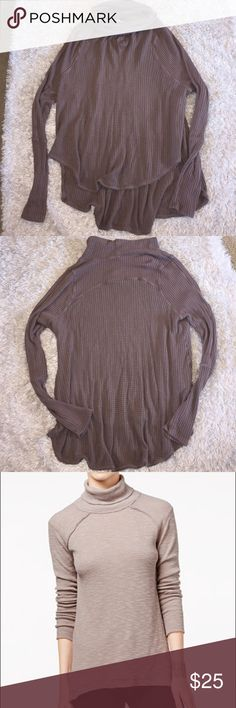 Free People High-Low Turtleneck Sweater Size L,  color is a soft brown! Excellent condition. Small blemish noted in pictures located on end of Sleeve, does not pierce through more than one layer. Feel free to ask any questions! No trades sorry, & offers thru offer button only! If it is listed as for sale, IT IS AVAILABLE! 😊 Free People Sweaters Cowl & Turtlenecks