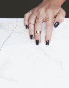 black nails and minimal rings
