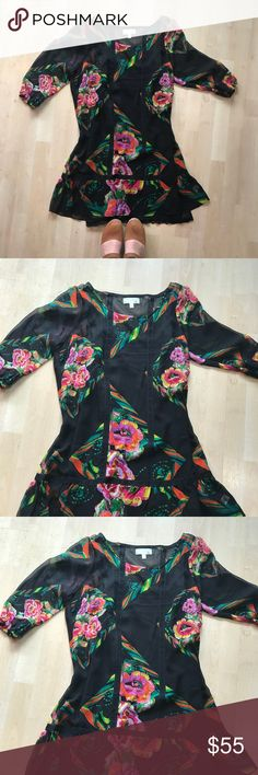 Anthropologie Dress! Floral Anthropologie Dress with a black slip. It's beautiful and in excellent condition Anthropologie Dresses