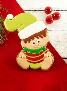 Baby Elf Cookies by | The Bearfoot Baker   #bearfootbaker #decoratedcookies #edibleart #cookieart #royalicing #rolloutcookies #simplecookietutorial #Christmas #Christmascookies #cookietutorial #elves #cookiesforsanta  #wintercookies