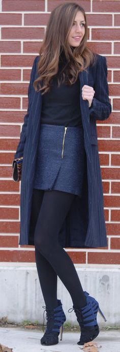 Navy and black outfit black sweater navy mini skirt tights and blue suede strappy high heels topped with a Pinstriped Coat LBV