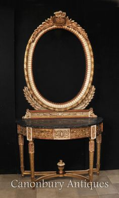 - Gorgeous Empire style mirror and console table set<br /> - Good size to this, perfect for an entrance hall or sitting room<br /> - Hand carved base and mirror frame incredibly ornate and finished in blushed giltwood<br /> - Giltwood has a lovely muted colour scheme, less gaudy than some of the brighter French furniture<br /> - Marble top to the demi lune console table is smooth and chip free<br /> - Hence every interior designers dream<br /> - Large mirror can definitely add light and…