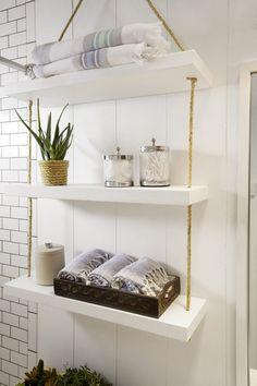 - SHW Home Decor Diy hanging shelves for small bathroom storage solutions. Bathroom Shelves Over Toilet, Bathroom Shelf Decor, Bathroom Storage Shelves, Toilet Storage, Bathroom Ideas, Basement Bathroom, Bathroom Cabinets, Bathroom Vanities, Bathroom Designs
