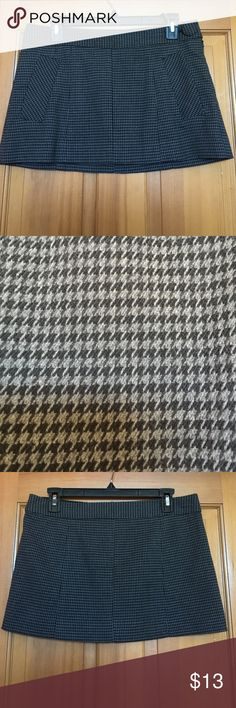 Guess Mini Skirt Never Been Worn - In great condition - No rips or pulls in material - The houndstooth print is extremely sophisticated - The material is heavy and feels very expensive. Made of a mixture of Polyester, Rayon and Spandex. Super cute for the Fall/Winter, when paired with a pair of black leggings and boots. Guess Skirts Mini