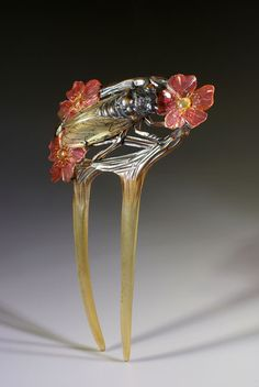 Lovely example of Art Nouveau ornament, made out of painted horn. The cicada has been riveted on the blossoming background. - Creative Museum