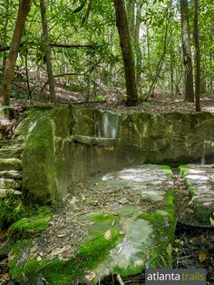 The Angel Falls Trail hikes to a stone bench and historic spring