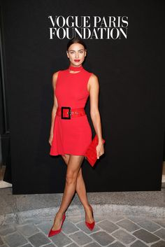 Irina Shayk was flawless in a #Versace Fall 2015 asymmetric red gown accessorized perfectly with red Versace shoes and clutch. #VersaceCelebrities