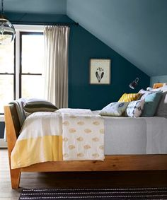 Decorating ideas for designing a beautiful bedroom with sloped ceilings. Sloped ceiling bedroom design ideas for storage, decorating, and space utilization. Blue Master Bedroom, Upstairs Bedroom, Bedroom Wall, Bedroom Decor, Bedroom Retreat, Indigo Bedroom, Cape Cod Bedroom, Attic Bathroom, Bedroom Modern