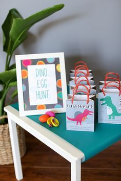 Set up a cute favor station with printables, favor bags and a a frame -- all (plus way more!) included in your Dinosaur #EviteParty in a Box.