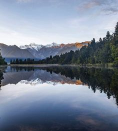 Sunrise reflections at Lake Matheson in glacier country, New Zealand by @samdeuchrass