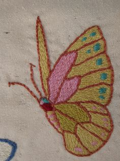 butterfly detail from embroidered silk panel by L. Ramke