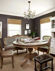 Fab combo of sofa, chairs, and ottoman around the dining-room table.    #diningroom #decorating