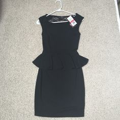 Black peplum dress with lace detailing Black peplum dress with lace detailing on the back. New with tags! Gorgeous on. Stretchy material so it fits a range of sizes! Never worn. Dresses Mini