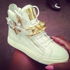 Lady's pimped out sneakers....cream and gold