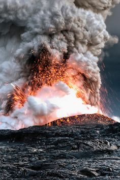 This picture was taken on Big Island in Hawaii in July 2008 from the Kalapana overlook. The Halema'uma'u volcano was erupting higher up on the island and the lava flowing into the sea was producing a gigantic plume of volcanic gas/water vapor. The lava moves in lava tubes beneath the hardened surface of more recent flows and is invisible until it reaches the sea. The volcano is still active in 2013.