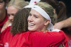 Bouchard win sinks Serbia. Shot at World Group tennis elite on deck.