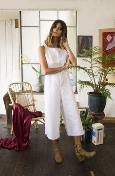 Classic linen jumpsuit with a low back. Can be tied in two ways, with adjustable straps and a wide cropped leg. Available in a variety of colours. Featured in crisp white. Please select colour and sizing during checkout.