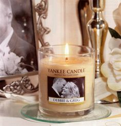 You might not know this... Yankee Candle makes customized candles for weddings. All you have to do is call and make an order!