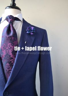 plum paisley tie and lapel flower