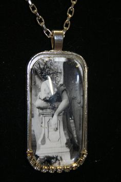 Mourning necklace sad angel Dr. Who cemetery by hudathotjewelry, $25.00