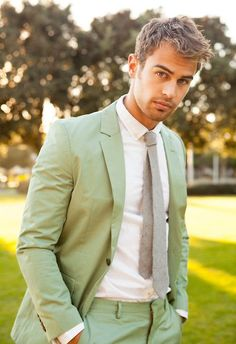 Nail that dapper look with a pastel green suit and a white classic shirt.   Shop this look on Lookastic: https://lookastic.com/men/looks/mint-suit-white-dress-shirt-grey-tie/12207   — White Dress Shirt  — Grey Tie  — Mint Suit