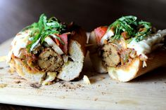 Homemade Italian Sausage on a Toasted French Baguette with Spicy Tomato Sauce, 'Mozzarella' and Basil Chiffonade