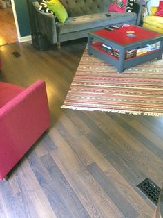 """African Rosewood: """"For the price, you can't do better. The snap lock planks are really easy to install. I love the way it looks in my home and most people can't tell it's not hardwood."""""""