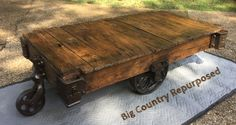 Antique factory cart. Would make great coffee table or accent table. I left all of the character this piece ever got and just put a medium brown stain on and clear coat. All original Oak and cast iron hardware.  Please see more at Big Country Repurposed Furniture on Facebook