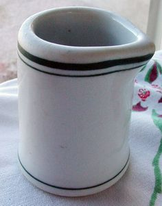 Restaurant China creamer White with Green  Why am I pinning this, you ask? Because I've got three in this shape in robin egg blue. I think they're actually individual syrup servers. I don't know the maker of mine. -Cat