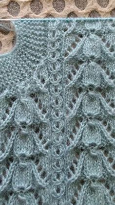Just the photo no pattern. Can't tell if the garter stitch is a neck band or an armhole. The lace is nice