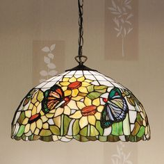 Papillon Pendant The Papillon Pendant, a display of nature in hand made Tiffany glass. H: W: 450 D: 450 Bulbs: 3 x 60 Fittings: Shade: 3 Light Pendant, Pendant Lamp, Pendant Lighting, Stained Glass Projects, Stained Glass Patterns, Tiffany Ceiling Lights, Tiffany Lamp Shade, Lounge Lighting, Art Deco Lamps