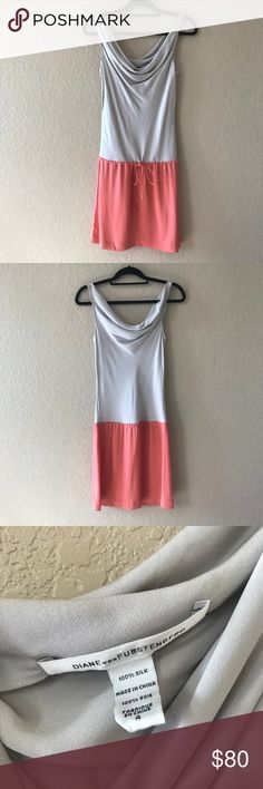 Diane von Furstenberg Silk Drop Waist Dress Girly sleeveless color block dress featuring a draped neckline and strings at waist. In excellent preowned condition, please note that one of metal from string is missing. Diane Von Furstenberg Dresses Mini