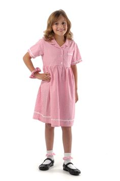 100% Cotton Classic #Gingham_School_Dress & Scrunchie This 100 per cent cotton gingham dress with simple pearl-style button front and gathered waist combines a classic easy-wear, easy-care design with the comfort of a natural fibre. Its sleeves, hem and breast pocket are edged with a pretty white cotton trim. Each gingham dress comes with a matching hair scunchie. It comes in seven popular colours white/red, white/green, white/navy, white/light blue, white/yellow, white/purple and…