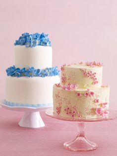 A small wedding cake (like the blue one) for the bride and groom, then a cupcake bar for everyone else?  I think I'm into that idea.