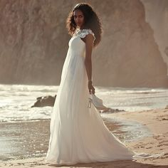 This flowing, romantic gown is absolutely perfect for an intimate beach wedding.