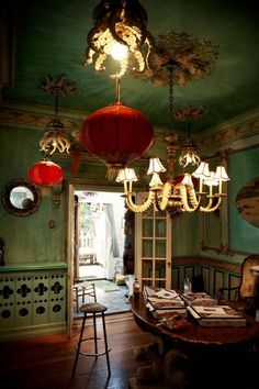 Whimsical & delicious! Jade mixes with scarlet in this room lit by fanciful octopi & hot air balloons