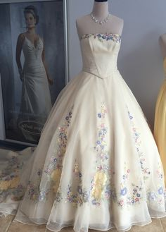 Popular Alfred Angelo Cinderella live action wedding dress with embroidered floral yellow blue pink