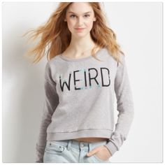 """WEIRD sweater top Gray """"weird"""" lightweight sweater top. SZ XS (fits like a S). Brand new with tags Aeropostale Tops Sweatshirts & Hoodies"""