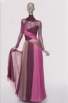 Valentino Fall/Winter 1986 Haute Couture    collection.    The crossover composition in silk crepe in a color block chiffon gown in shades of pink   and grey with purple chiffon yoke and sleeves