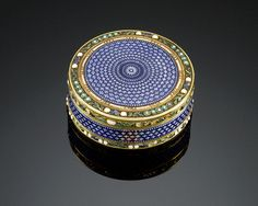 Brilliant guilloché enamel adorns each side of this exceptional French gold snuff box. This circular-formed box was crafted by and bears the marks of Jean-Joseph Barriere as well as the charge, discharge and later countermark of Henri Clavel and Jean François Kalenduin.