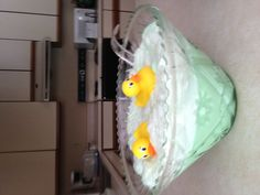 Made green baby shower punch from lime sherbet, pineapple juice, ginger ale and rubber duckies-
