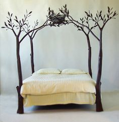 Coolest bed I've ever seen! This would totally inspire me to create a forest/nature themed room.