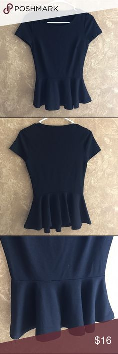 Black Peplum Top Black short sleeve well fitted top. Peplum bottom. Never worn so in great condition. Stretchy material 75% polyester 20% rayon 5% spandex Forever 21 Tops Tees - Short Sleeve