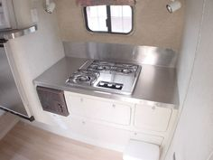 Stainless steel sink and lots of countertop space in the kitchen