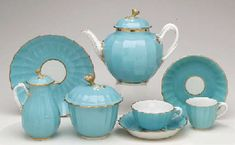 1775 A WORCESTER TURQUOISE-GROUND FLUTED PART TEA AND COFFEE-SERVICE  Circa 1775, blue pseudo Chinese fret marks, probably decorated in the London workshop of James Giles In the Sèvres style, with flower finials, entwined branch handles and gilt line rims, comprising: A teapot, cover, and stand, the pot 6 1/8in. (15.6cm.) high; the stand 7 1/8in. (18.1cm.) diam.  Christies lot176