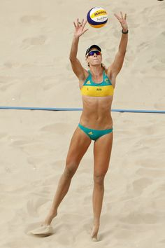 Nicole Laird of Australia sets during the Women's Beach Volleyball preliminary round Pool C match against Anouk Verge-Depre and Isabelle Forrer of Switzerland on Day 3 of the Rio 2016 Olympic Games at the Beach Volleyball Arena on August 8, 2016 in Rio de Janeiro, Brazil.