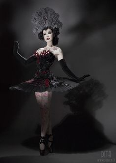 """vintagegal:    yeeaboii:    Oooh!I doubt any of you have seen this picture of Dita Von Teese    This picture ( by Sheryl Nields) was taken several years ago and has been widely available on her website and google ever since. The costume is for the """"Black Swan"""" show she performs sometimes."""